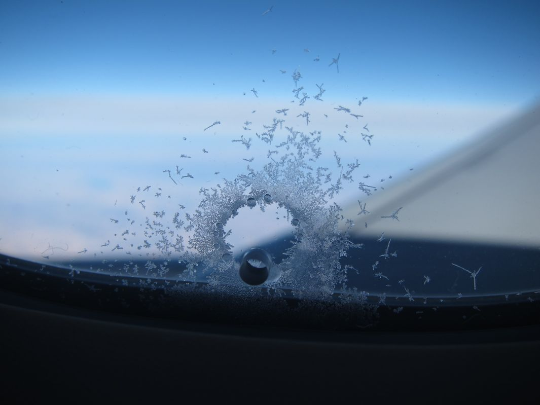 The Airplane window ice ring