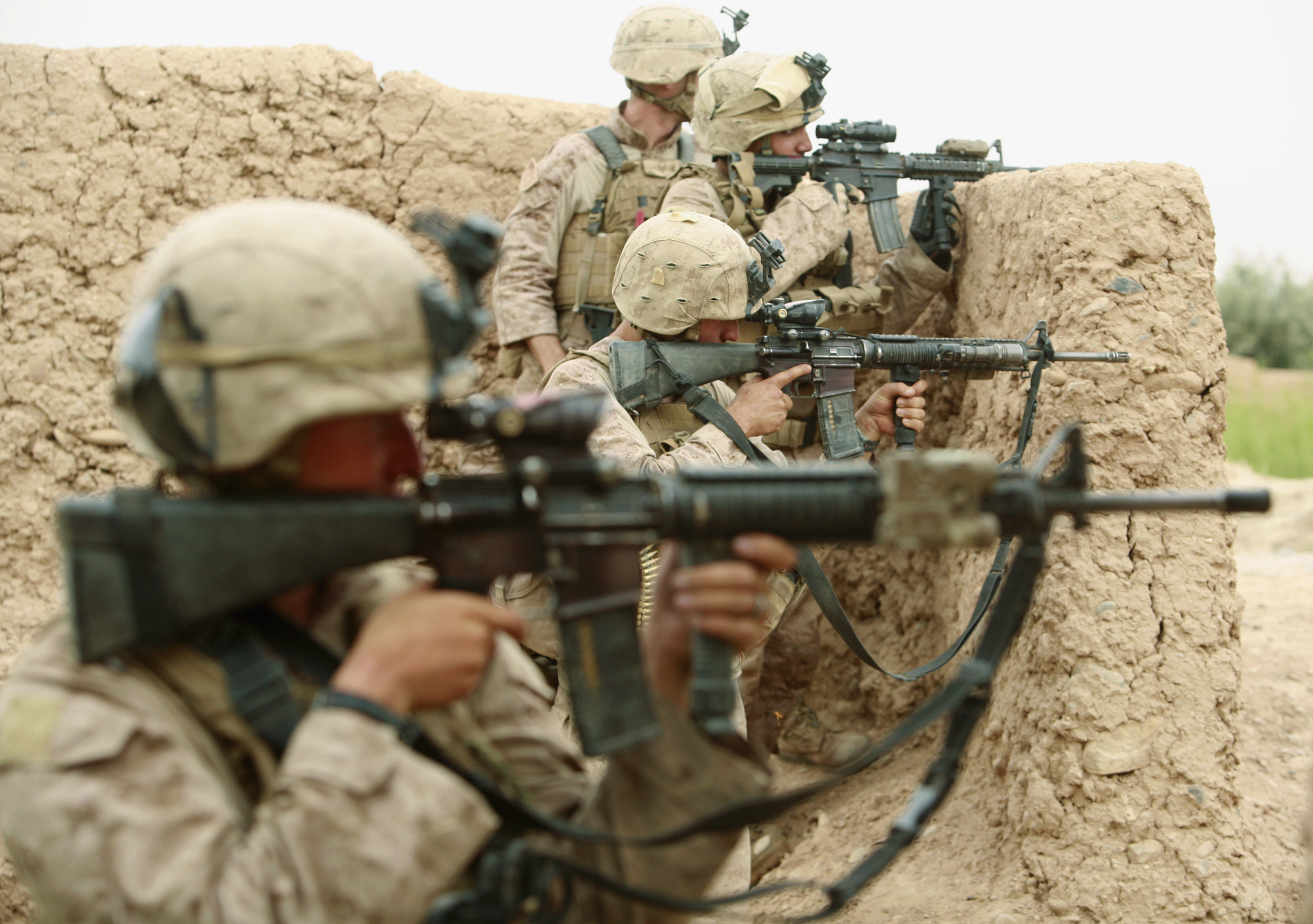 U.S. Marines from Lima Company 3rd Battalion, 6th Marines aim their weapons during a shootout with Taliban fighters in Karez-e-Sayyidi in the outskirts of Marjah district