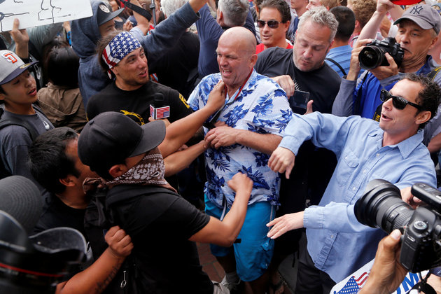 Trump supporters and anti-Trump demonstrators clash outside a campaign event for U.S. presidential candidate Donald Trump in San Diego